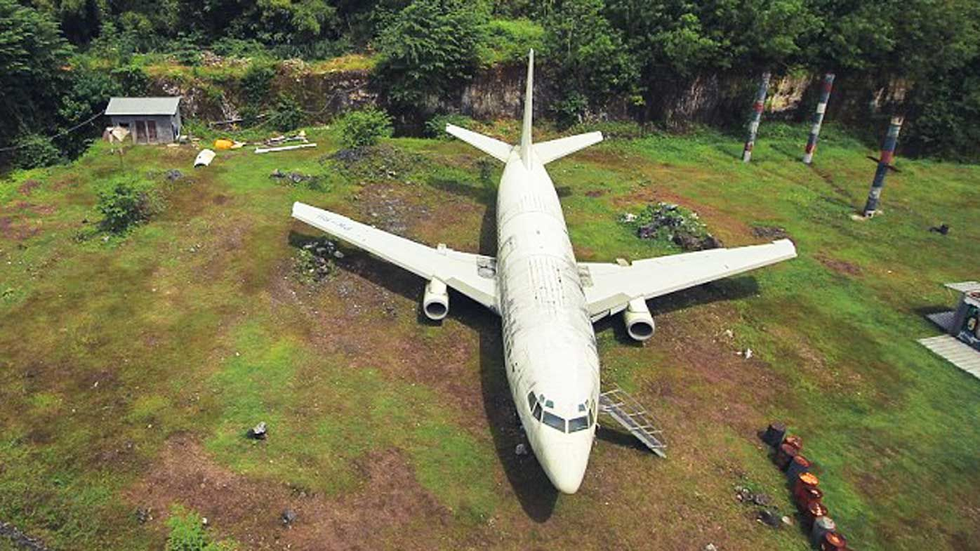 Mysterious abandoned passenger jet found in Bali field