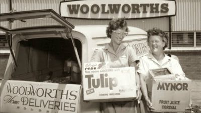 Staff pack the Woolworths home delivery van at the Green Valley store in 1964. (Supplied)
