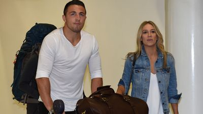 Sam Burgess and fiancee Phoebe Hooke arrive at the international airport in Sydney earlier this year. (AAP)