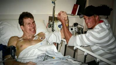 Former AFL player Jim Stynes and television presenter Jules Lund