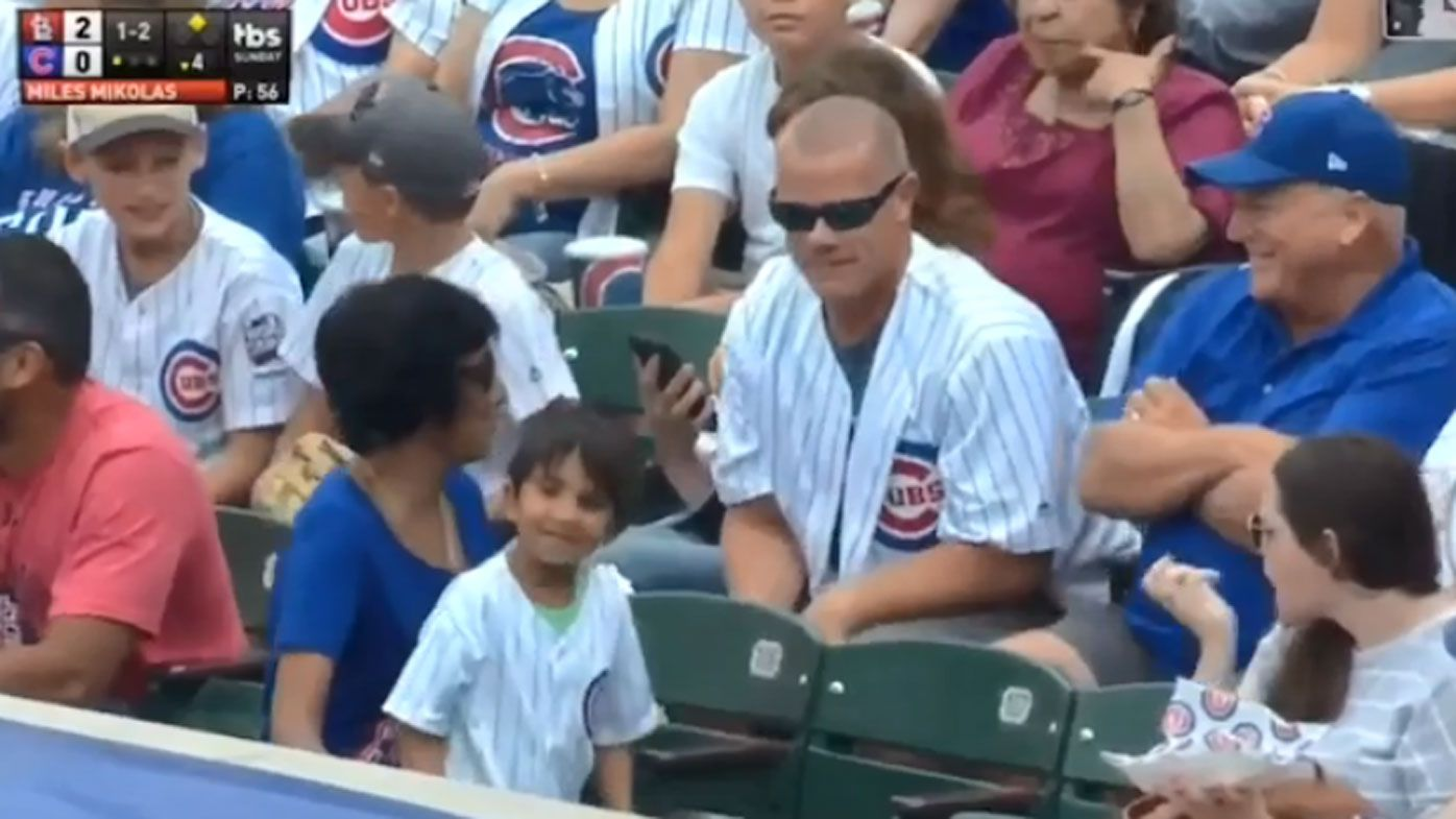 Man laughs after snatching baseball from little boy at game
