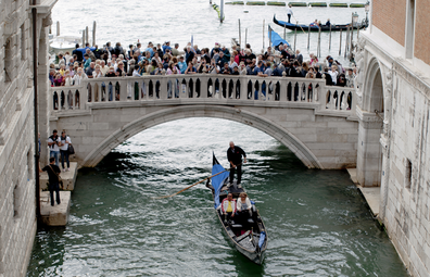 Venice overtourism: bridge crowded with tourists