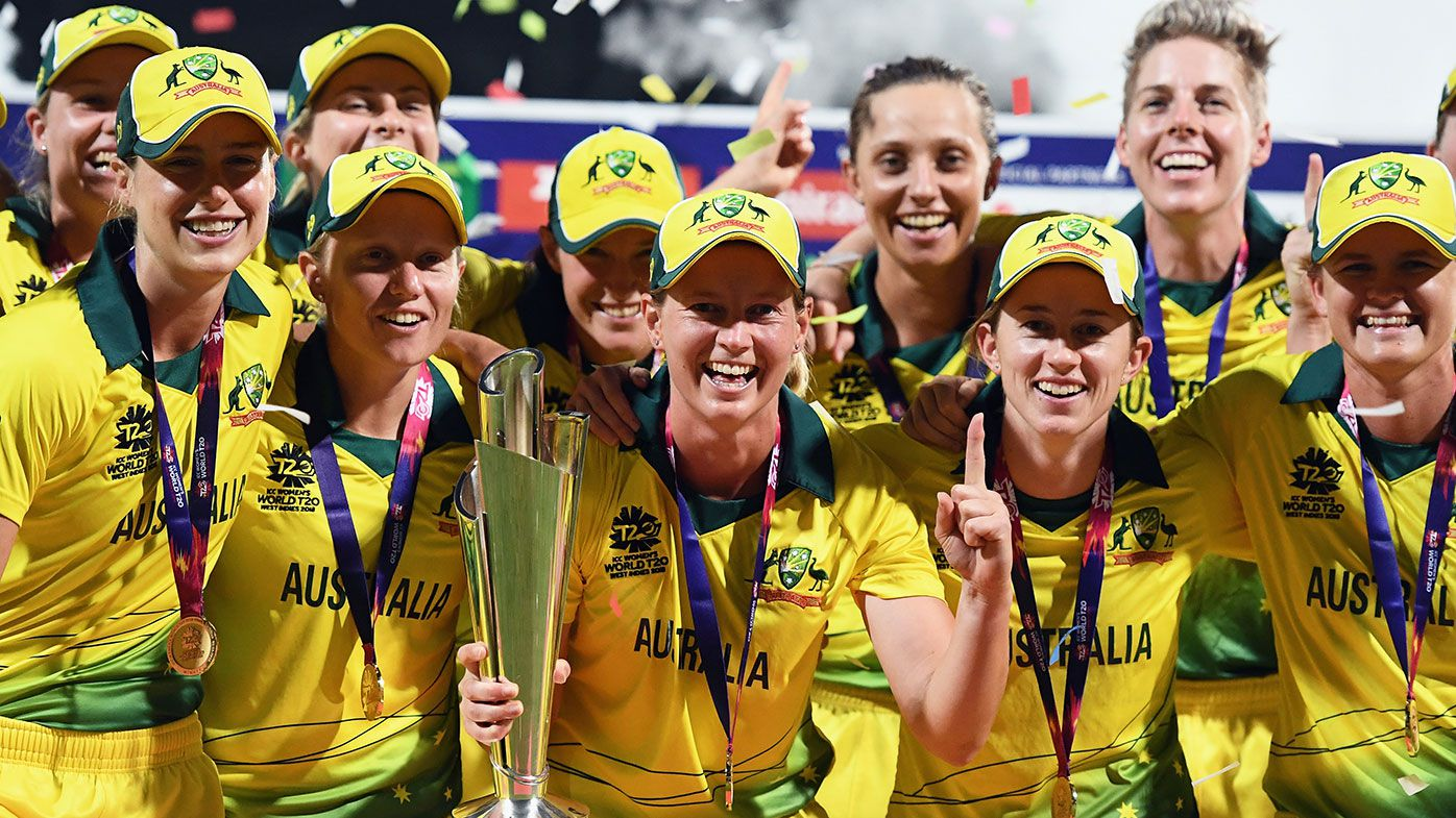 Australia celebrates with the World T20 trophy after beating England in the final.