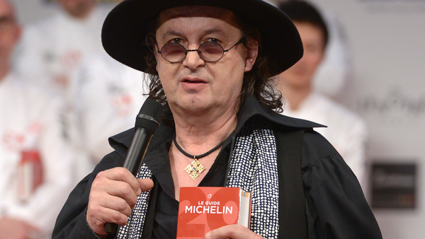 French chef Marc Veyrat holds a Michelin Guide book