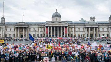 Anti-Trump protesters pack Trafalgar Square in London.