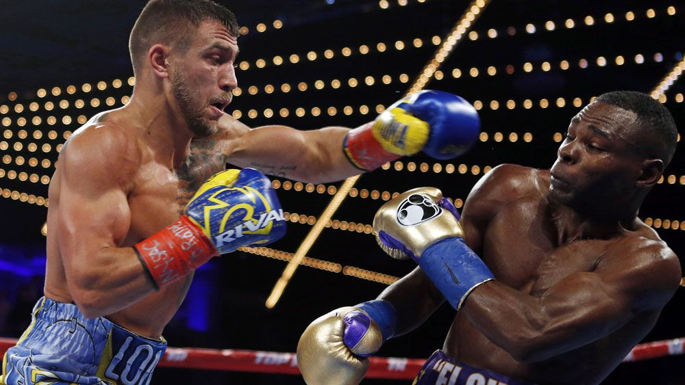Vasyl Lomachenko wins boxing super-featherweight world title fight after Guillermo Rigondeaux quits