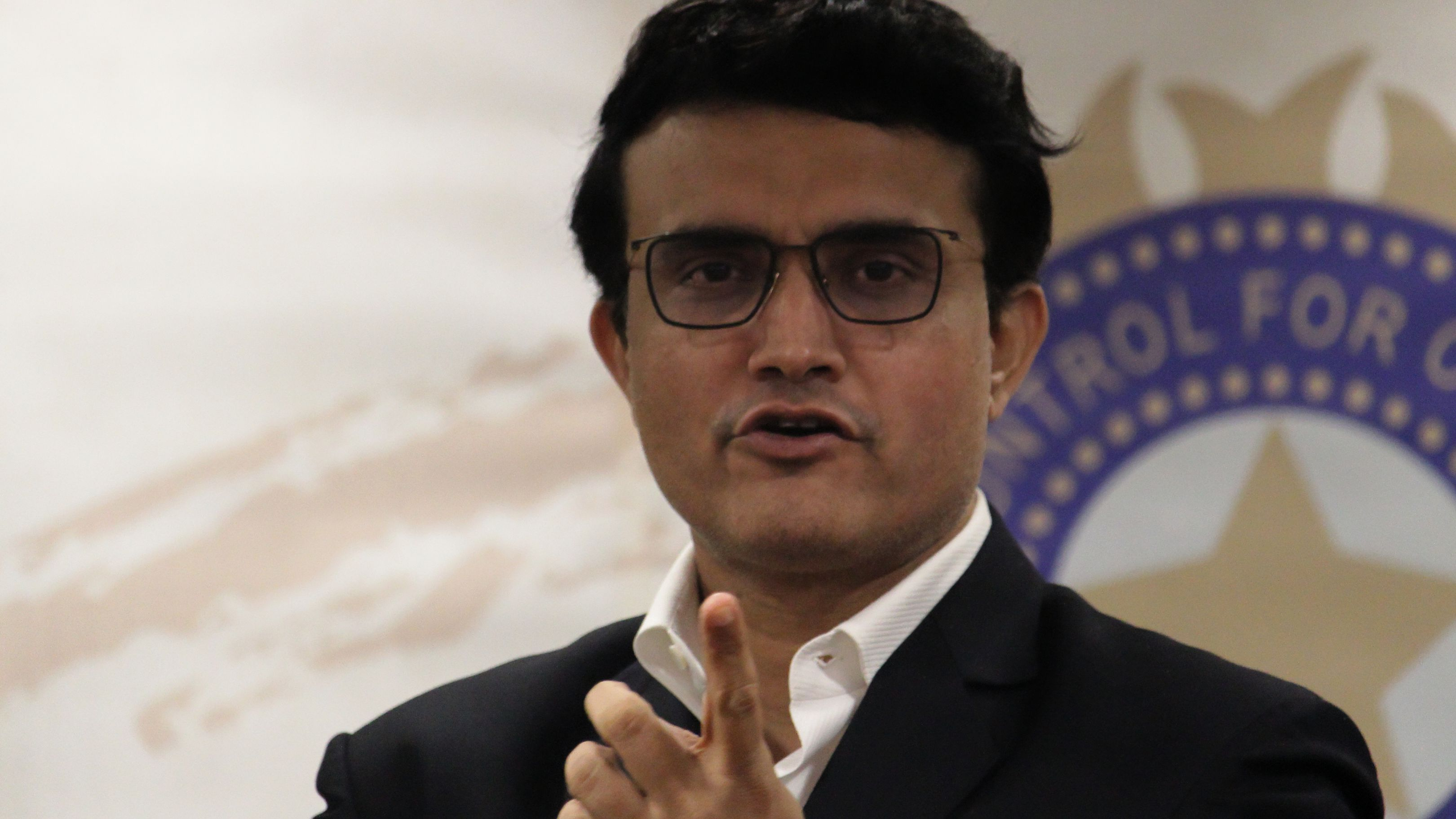 Former Indian cricketer Sourav Ganguly reacts during a press conference.