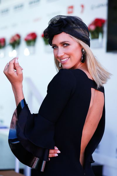 <p>No. 9 Backing a winner</p> <p>Nikki Phillips in a Daniel Avakian dress with a Kerrie Stanley headpiece and Chelsea de Luca earrings.</p>