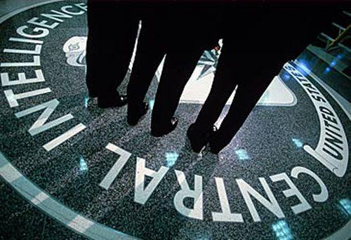 Men standing on CIA emblem (Getty)