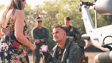 A U-S Marine who was deployed to Australia on a six-month rotation, has used a chopper to propose to his girlfriend, who lives in Darwin.