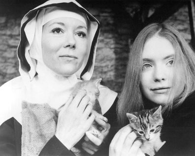 English actresses Diana Rigg (left), as Dame Phillipa, and Judi Bowker as Joanna, in the TV movie 'In This House Of Brede', directed by George Schaefer, 1975