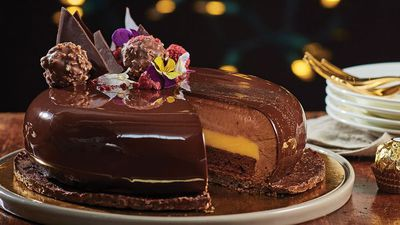"""<a href=""""http://kitchen.nine.com.au/2016/12/15/11/36/golden-christmas-cake-with-chocolate-jaconde-mousse-and-passionfruit-curd"""" target=""""_top"""">Golden Christmas cake with chocolate jaconde, mousse and passionfruit curd</a>"""