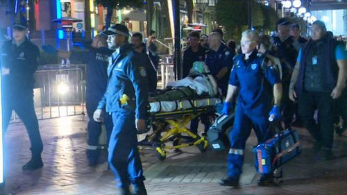 A paramedic has been allegedly assaulted in Sydney's CBD early this morning while trying to help an unconscious women.