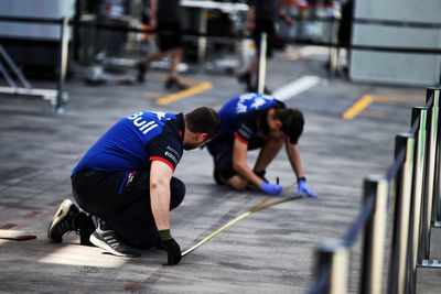 Final preparations underway! Scuderia Toro Rosso mechanics work in the pits. (AAP)