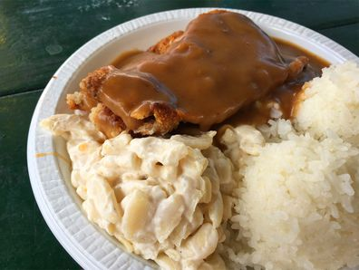 Plate dinners - chicken and rice with gravy all over and macaroni salad from Rainbow Drive-In