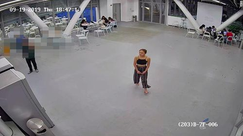 For over an hour, she can be seen pacing around the campus, waiting for elevators, walking around an outdoor area on the roof and through a canteen where other students are seen huddled over laptops or eating dinner. At some point, she ditches her bag and then her shoes, continuing barefoot.