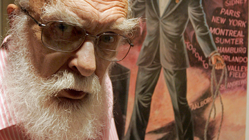 James Randi is shown in front of a poster at his home in Fort Lauderdale, Florida. (AP Photo/Alan Diaz, File)