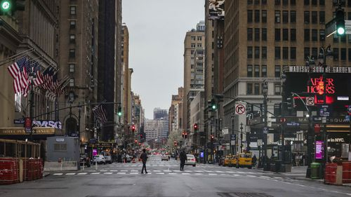 A usually busy 7th Avenue is mostly empty of vehicles, the result of citywide restrictions calling for people to stay indoors and maintain social distancing in an effort to curb the spread of COVID-19.