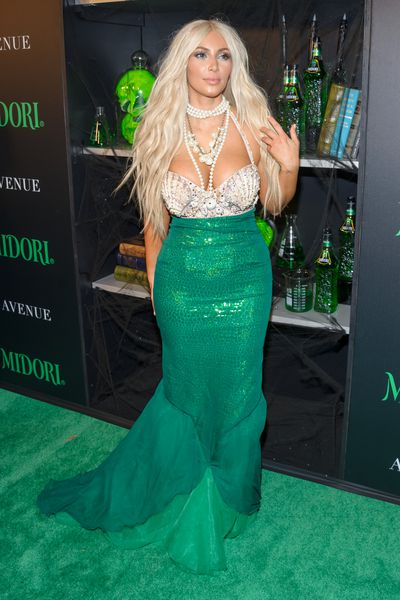 Kim Kardashian attends the Midori Green Halloween Party on October 27, 2012, dressed as a mermaid.