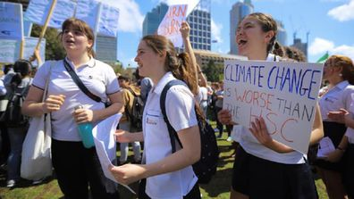 School-age climate change protesters marching in the streets of Sydney.