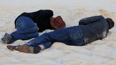 After a big night, these blokes weren't too fussy about where they slept. (All photos AAP)