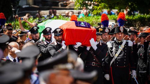 Carabinieri officers carry the Italian flag draped coffin containing the body of officer Mario Cerciello Rega during his funeral in his hometown of Somma Vesuviana.