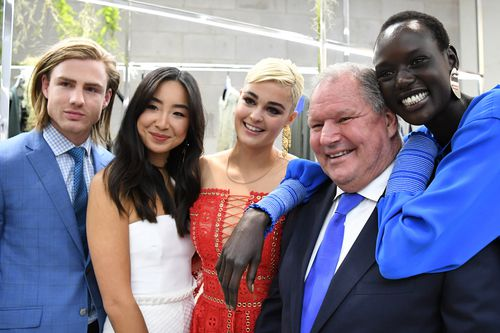 Robert Doyle poses for photos with the ambassadors of Melbourne Spring Fashion Week last year. (AAP)