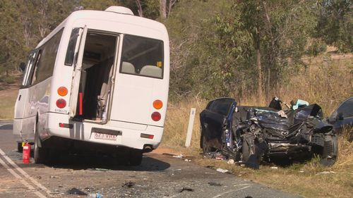 A bus with 22 people on board, including the driver, and a car with a single female driver collided in Logan this morning.