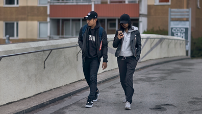 A young couple walks along a bridge in Rinkeby-Kista borough in Stockholm, Sweden, Tuesday, April 28, 2020.
