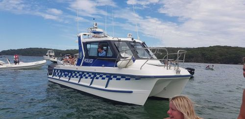 Water police patrolling the area at Lilli Pilli.