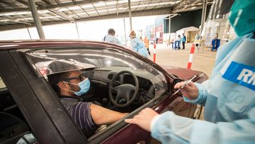 A nurse administers the Pfizer COVID-19 vaccine at a drive through vaccination centre in Melton in Melbourne.