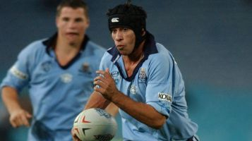Johnathan Thurston playing for NSW.