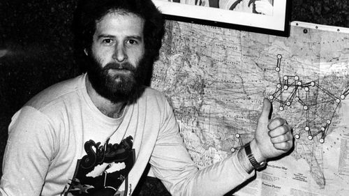 Michael Gudinski points to a map showing one of his first signings, the Skyhooks', tour of America.