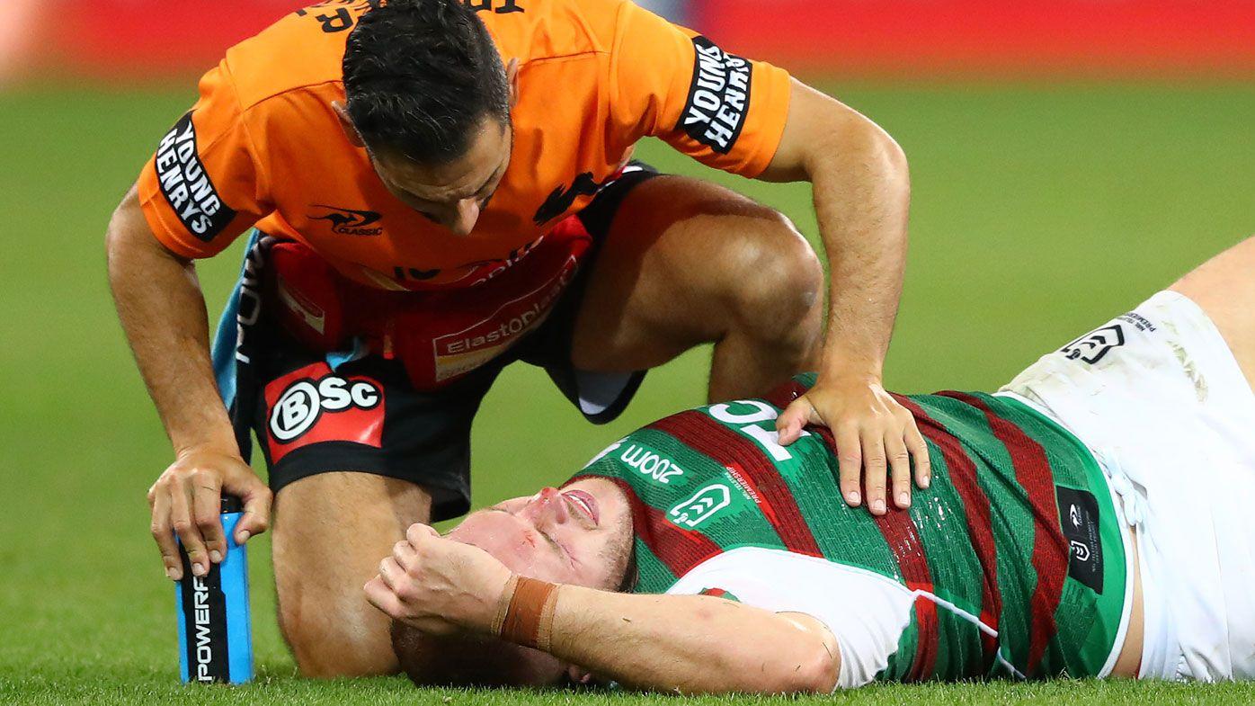 Rabbitohs star Tom Burgess taken to hospital with 'burner' neck injury