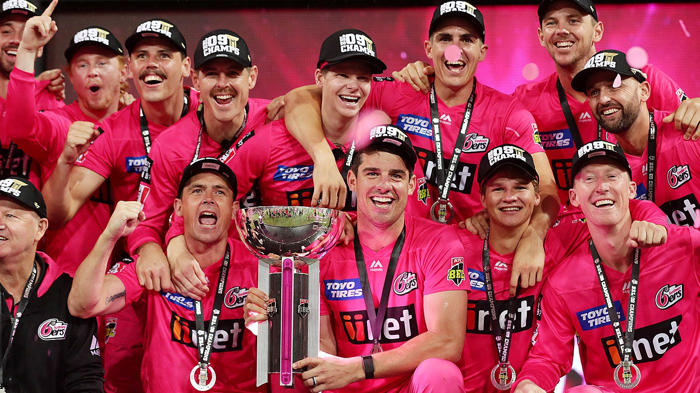The Sixers pose with the trophy after winning the Big Bash League Final match