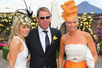 Pose for the cameras, Warnie! Shane gets a shot with excited punters.<br/><br/>Image: Getty