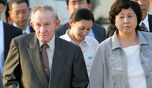 U.S. Army deserter to North Korea, Charles Jenkins, left, escorted by his wife Hitomi Soga. (Photo: AP).