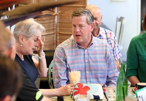 Queensland Opposition Leader Tim Nicholls chats to his mother Barbara as he meets friends and family at a cafe in Brisbane. (AAP)