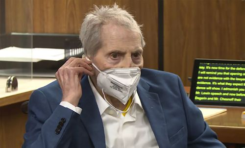 FILE - In this still image taken from the Law&Crime Network court video, real estate heir Robert Durst watches as his defense attorney Dick DeGuerin presents a new round of opening statements in the murder case against Durst after a 14-month recess due to the coronavirus pandemic in Los Angeles County Superior Court in Inglewood, Calif., on Wednesday, May 19, 2021. Durst, 78, an heir to a New York commercial real estate empire, is charged with first-degree murder in the slaying of his best frien