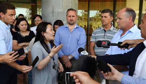 A resident asks questions of Icon Managing Director Julian Doyle at a press conference outside the Opal Tower at Sydney Olympic Park.