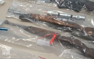 Perth couple charged after police find military-grade weapons, cash and drugs