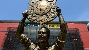 Bronze statue of Rugby League great Wally Lewis in front of Suncorp Stadium. Picture: AAP