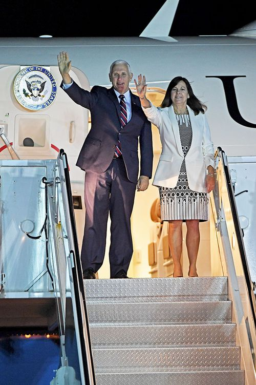 US Vice President Mike Pence and his wife Karen wave as they exit Air Force 2 after arriving in Cairns.