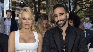 Pamela Anderson and Adil Rami attend fashion show
