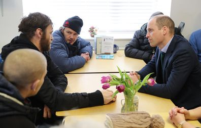 Prince William speaks with service users during a visit to The Beacon, a day centre which gives support to the homeless and vulnerable people.