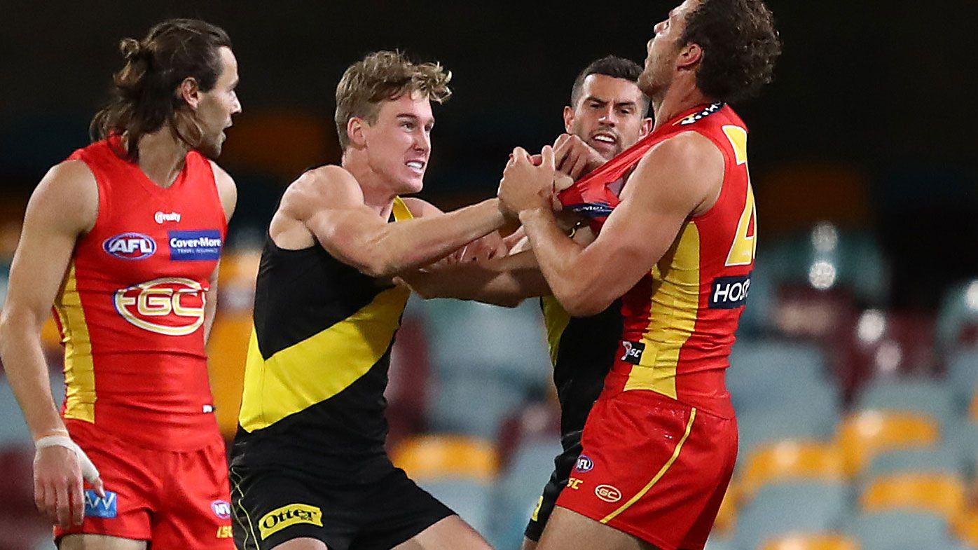 Tom Lynch scuffles with Jarrod Witts during Round 12 of the AFL. (Getty)