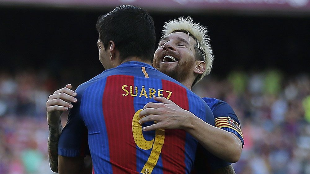 Suarez, Messi run riot for six-goal Barca