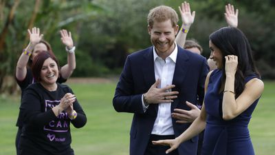 Good sports: Harry and Meghan watch exhibition