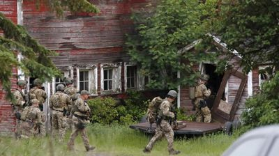 <p>The manhunt for the two escaped killers has narrowed to a small town after a possible sighting.</p><p>  Richard Matt, 49, and David Sweat, 35, have been on the run since Saturday morning after escaping from their cell in the maximum security Clinton Correctional Facility in Dannemorra. </p><p>  While police are yet to comment, busloads of heavily armed officers have reportedly descended on the town of Willsboro, 60km south of the jail. </p><p>  It is the prison's first successful escape in its 170-year history, and has been likened to that seen in the film The Shawshank Redemption. </p><p>  </p>