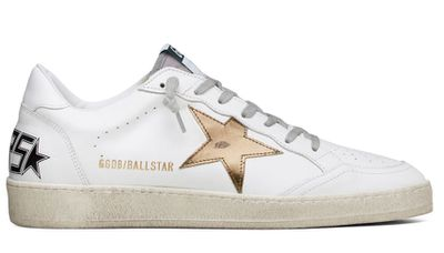 """<a href=""""http://www.sneakerboy.com/shop-sneakers/golden-goose-mens-ball-star-fw17ggdb4.html"""" target=""""_blank"""">Golden Goose Sneakers, $480.</a><br />"""